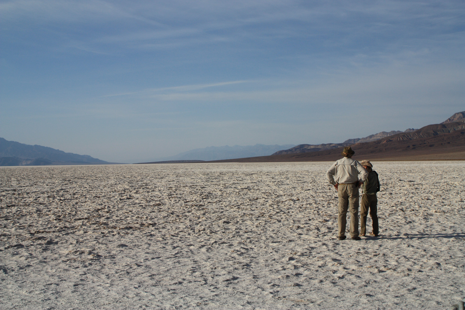 Hikers look out at Badwater Basin in Death Valley National Park