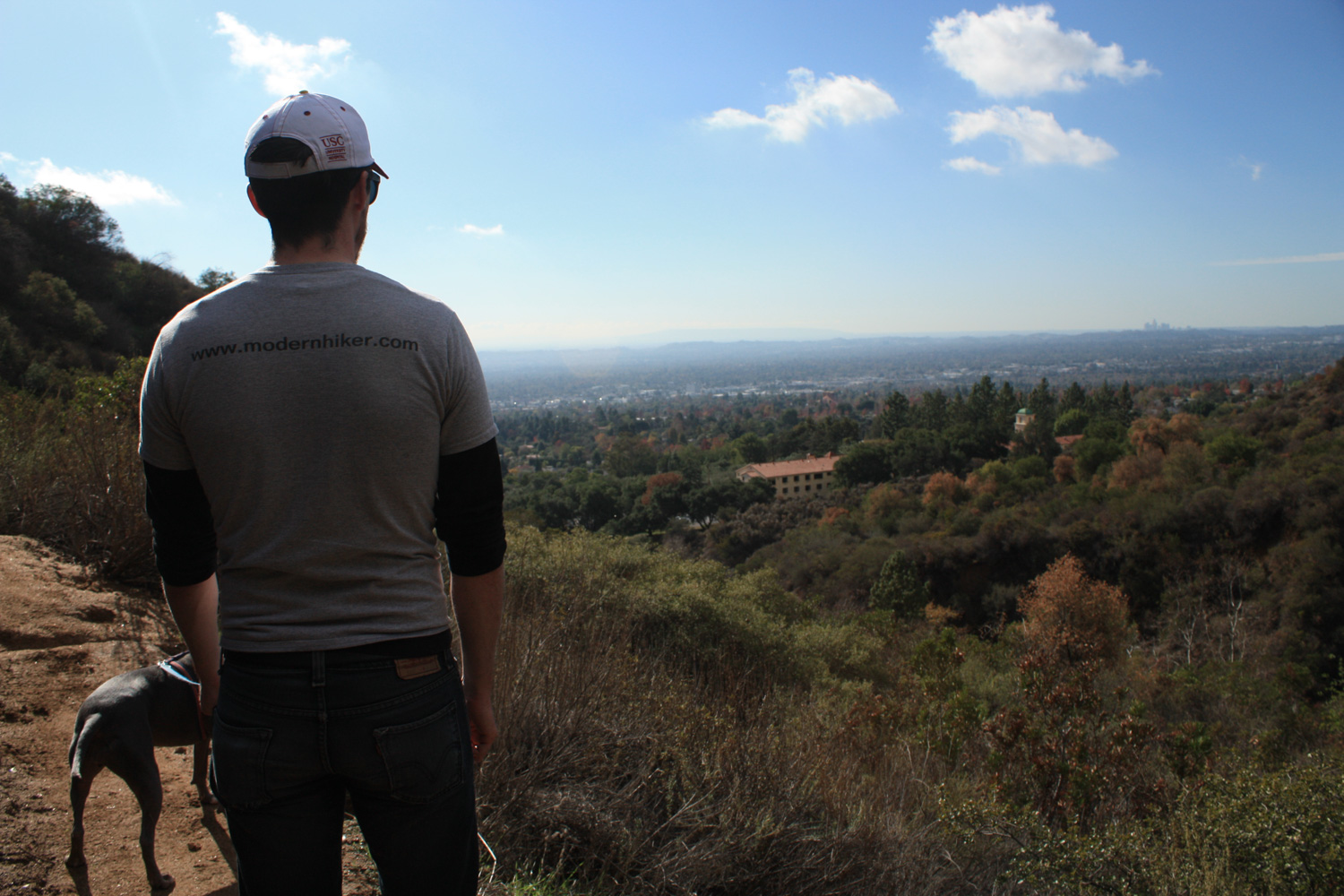 a hiker looks out at the landscape from Jones Peak