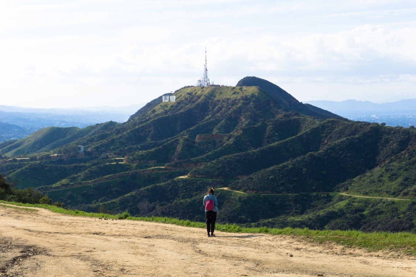 hiker on the north trail near mount hollywood with mount lee behind her