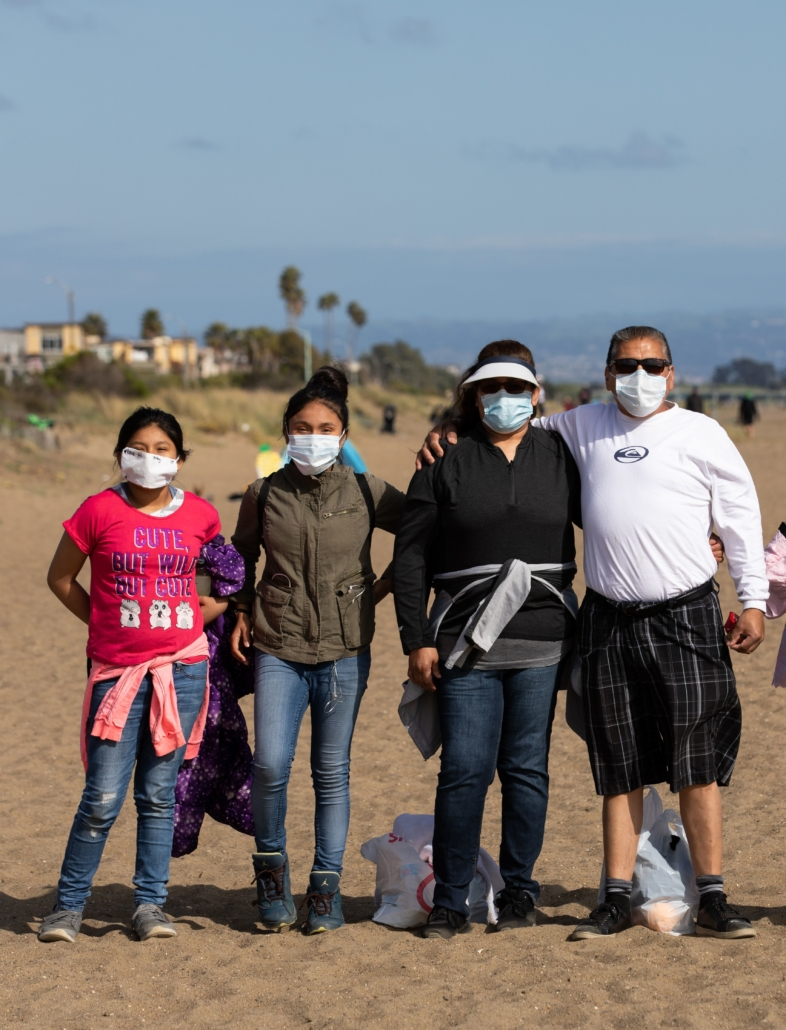 hikers wear masks on the beach